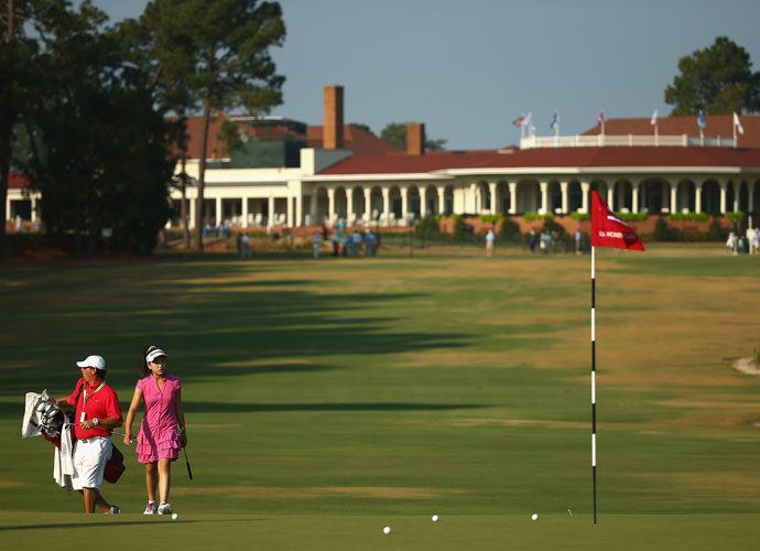 Lucy Li walks on the first green during a Wednesday practice round at Pinehurst.