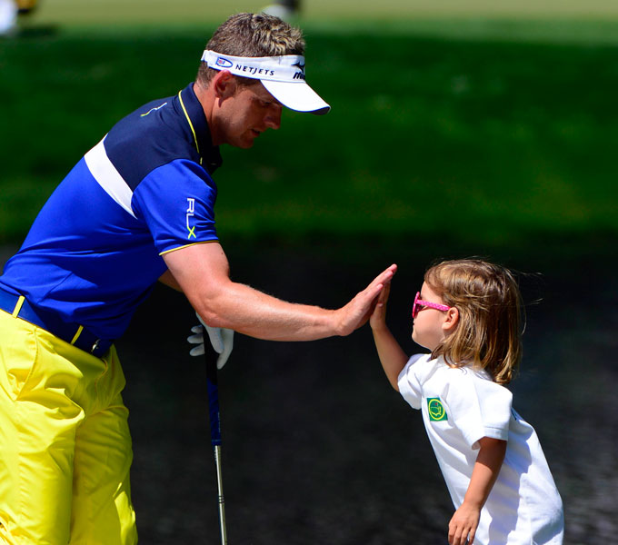 Donald gave his daughter a high-five on the fourth green.