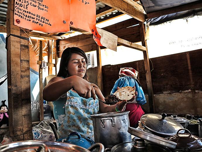 In downtown Juárez, street vendors make tortillas by hand.