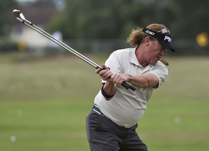 Miguel Angel Jimenez warms up on the range before his Monday practice round.