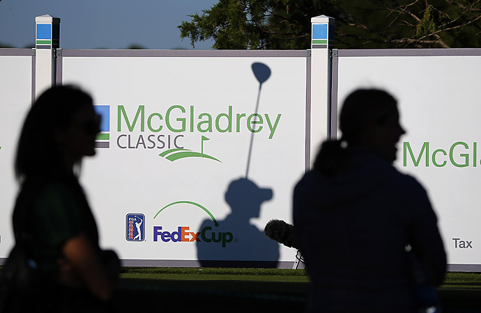 Mark Wilson casts a shadow on the McGladrey Classic sign on the 16th tee.
