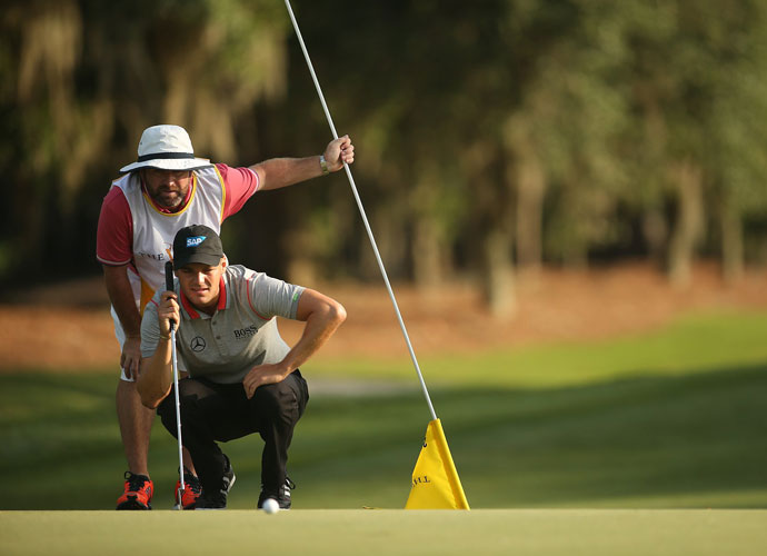 Martin Kaymer studies a putt with caddie Craig Connelly. Kaymer made five birdies in the second round.