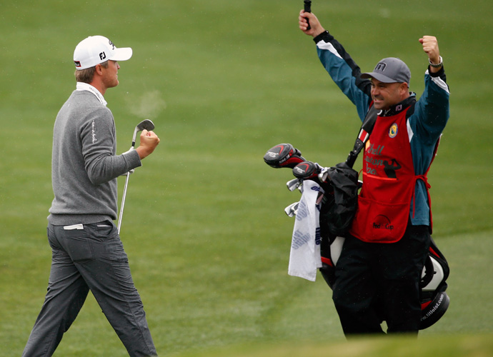 Jones celebrates with his caddie Scott McGuiness.
