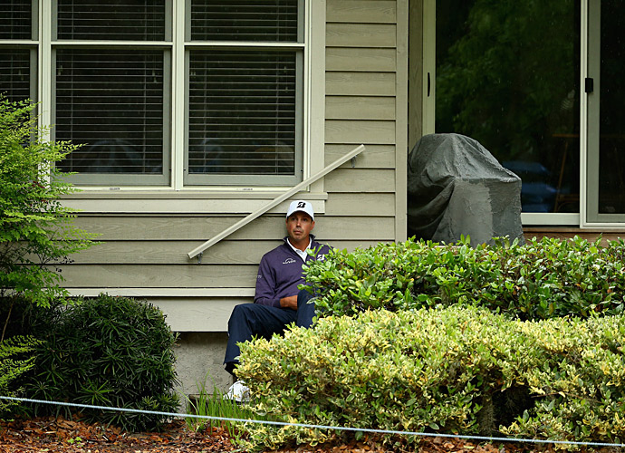 Kuchar found shelter  from the rain outside a house on the course.