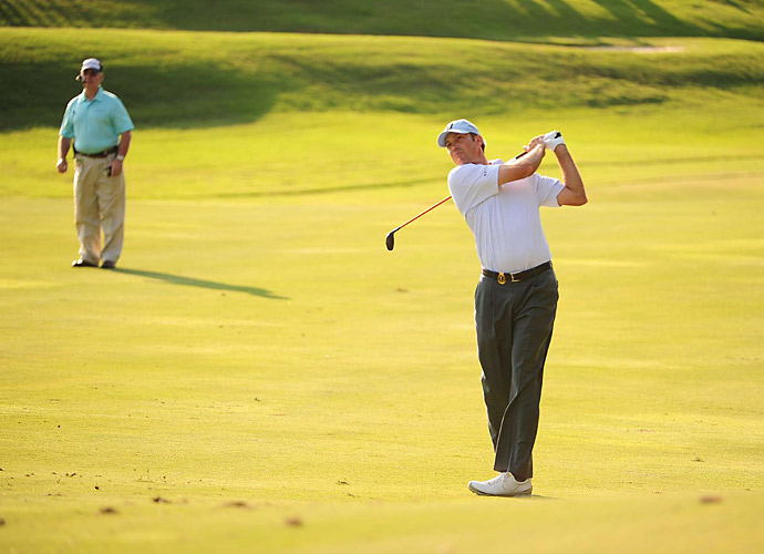 Defending champion Matt Kuchar shot a 71.