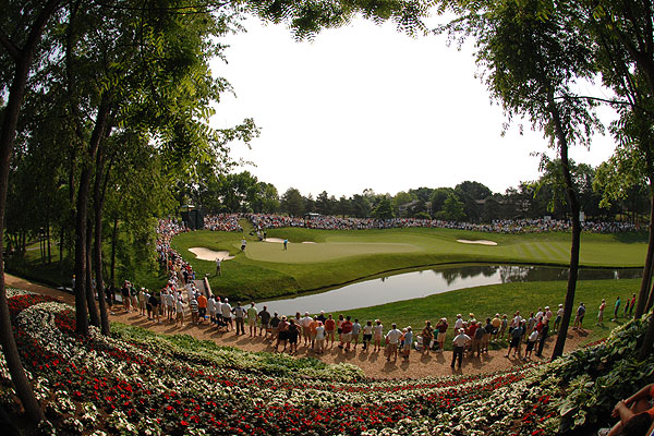 """Great backgrounds and a great field make Jack Nicklaus's Memorial Tournament one of the most popular stops on Tour for golf photographers. I created this shot of Woods on the fifth green using a fisheye lens."""