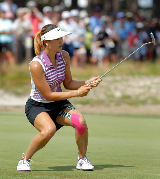 Wie reacts to a missed putt on the 11th.
