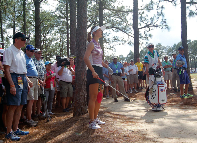 "Michelle Wie lines up a shot from out of bounds on the 12th. ""It's tough out there,"" Wie said after the round. ""My system got a little overheated. You can't be in the trees here. But I felt like I grinded out there."""