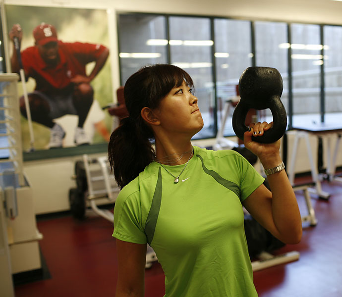 As a student at Stanford, Michelle Wie worked out under the watchful eye of fellow Cardinal Tiger Woods.