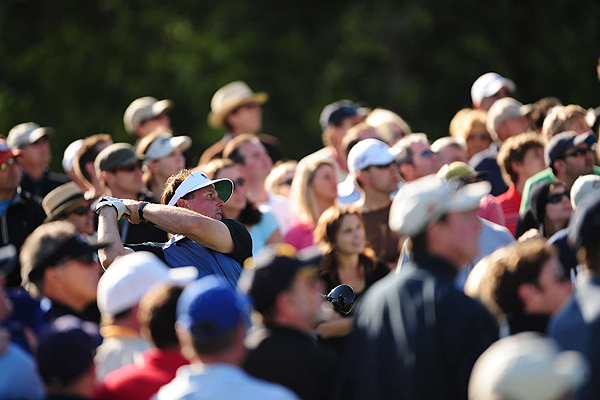 Swallowed up in the crowd, Phil Mickelson blasted his tee shot on the 18th hole on Saturday.