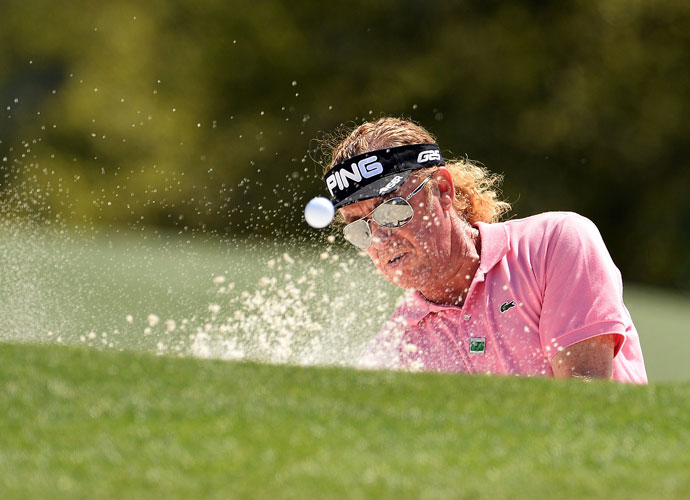 Miguel Angel Jimenez blasts out of a bunker during his opening-round 71. He was 4-under after nine before shooting 39 on the back.