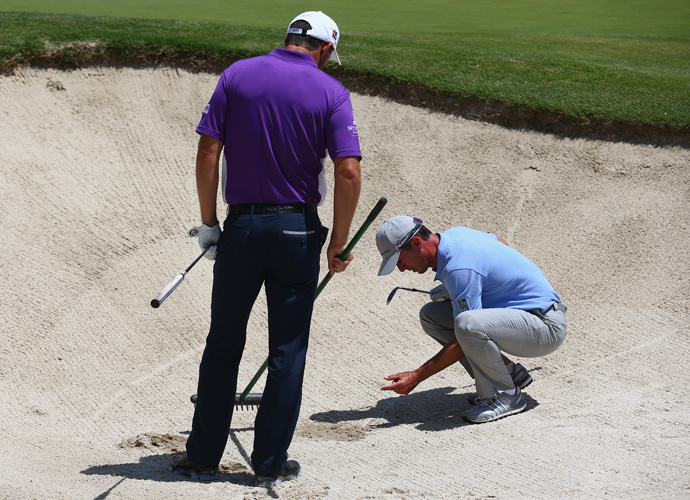 Weir and Padraig Harrington both ended up in the same bunker on the ninth hole .