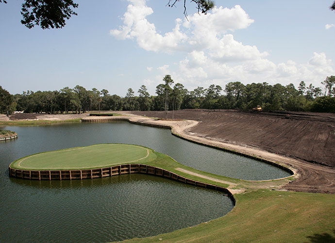 "9. Wallowing in the Muck: The huge mounds at TPC Sawgrass weren't planned, they simply evolved, says Dye. ""The more muck I dug up, the higher the mounds became, but to our pleasant surprise, they looked great. We planned on ten- to twelve-foot-high mounds, but soon they approached thirty to forty feet and provided an amphitheater effect that really embellished the course."""