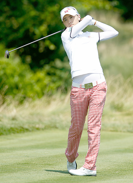 Wild and wonderful South Korean golfer Na Yeon Choi did her version of the Anthony Kim approach, superathletic with gonzo accessories. In this case, red tablecloth-check trousers, white compression undershirt, striped-sleeve shirt, and white belt with big statement gold buckle. Go for it, baby!