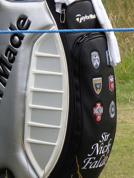 earned the badges on his TaylorMade golf bag by winning major championships.