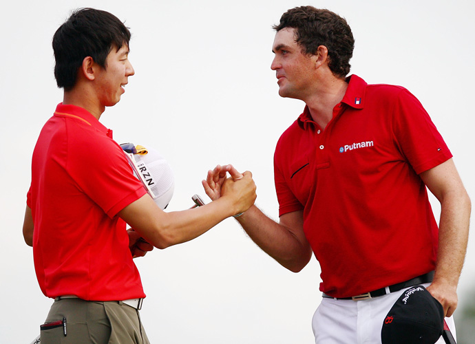 Keegan Bradley congratulates playing partner Noh on the victory.