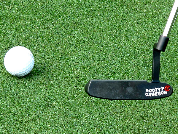 Unlike this gamer, the Scotty Cameron Newport 009 prototype Ogilvy practiced with Tuesday had a line on the back flange that helped the 2006 U.S. Open winner center the ball more easily at address. Judging by the strike pattern on the putter's face, it was helping.