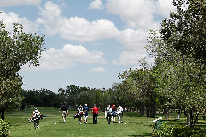 "Each player at Campestre is required to take a caddie. Bringing drinks? A special ""beer caddie"" will be assigned to your group. It can result in quite an entourage on the fairway."