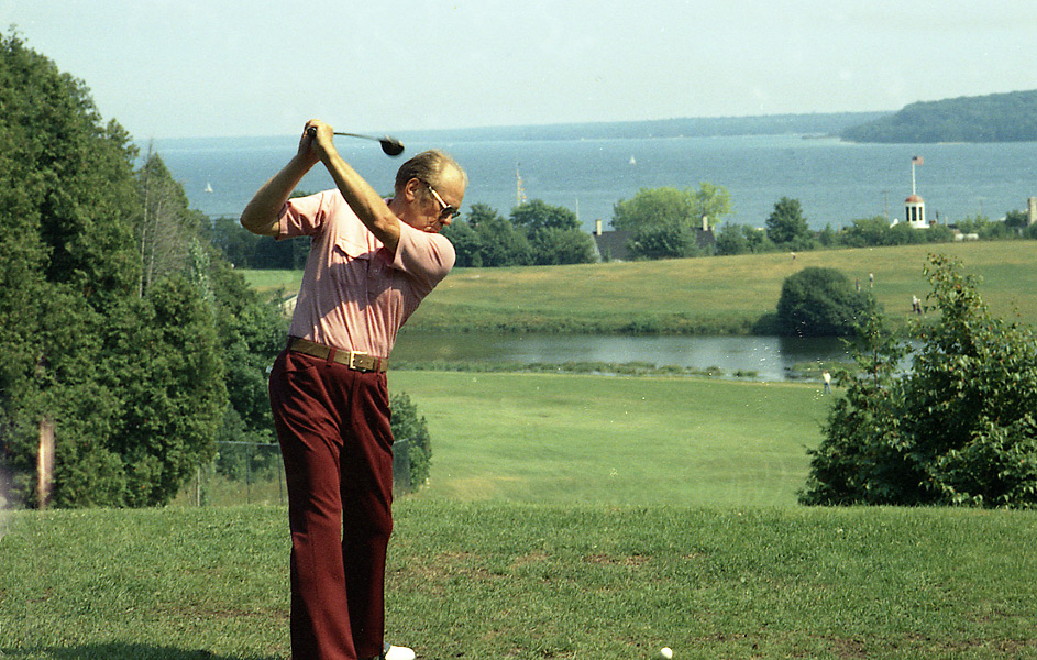"""Had to like his good nature and ability to take a ribbing about being an awful golfer. Without Ford, Bob Hope would've lost 20 percent of his joke file."" —Van Sickle. Photo: President Ford tees off at Mackinac Island in Michigan on July 13, 1975."
