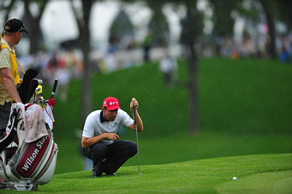shot 69 Saturday, but a bogey on the 18th hole dropped him into a tie for second and knocked him out of the final pairing with Tiger Woods. A light rain fell as the final groups were finishing the third round.