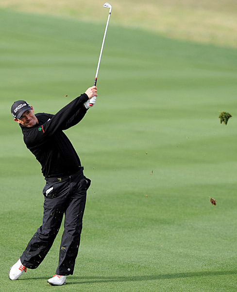 Padraig Harrington opened with a four-under 68 to finish one behind leader Matt Bettencourt.