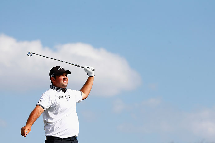 Patrick Reed hits out of a fairway bunker on the second hole of his 1-up victory over Graham DeLaet.