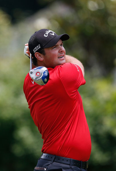 Patrick Reed watches his tee shot during his second consecutive 68. Reed, -6, earned a share of the lead after two rounds.