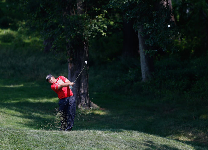 Patrick Reed hits an approach shot on the 14th hole. He has two victories this season: the Humana Challenge in January and the WGC-Cadillac Championship in March.