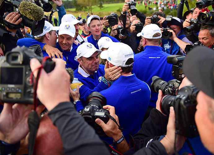 European captain Paul McGinley embraces Rory McIlroy after the win.