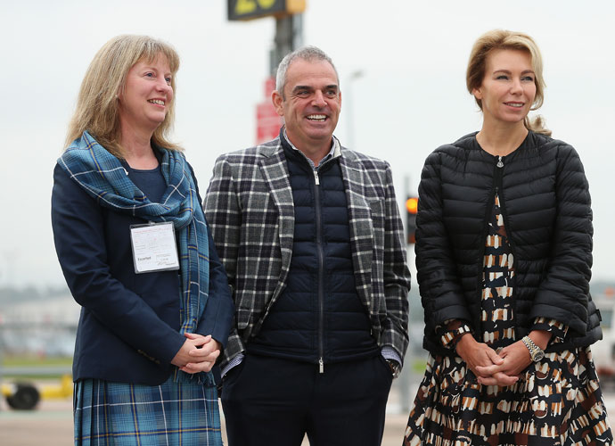 European Captain Paul McGinley awaited the American team's arrival at the Edinburgh Airport with his wife Alison (right) and Shona Robison, Scotland's Minister for Sport.