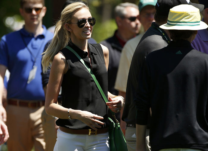 Paulina Gretzky makes her way around Augusta National to watch fiance Dustin Johnson play the 2014 Masters.