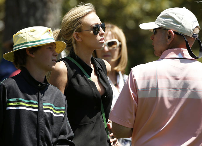 Paulina Gretzky watches Dustin Johnson play the first round of the 2014 Masters.