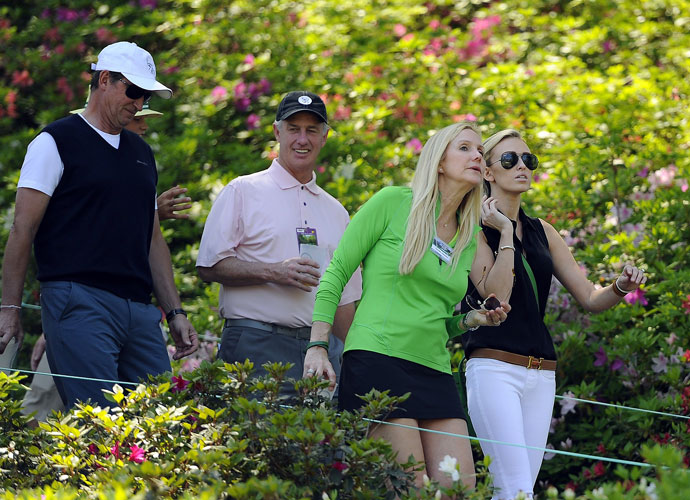 Wayne Gretzky (left) and daughter Paulina watch Dustin Johnson play the first round of the 2014 Masters.