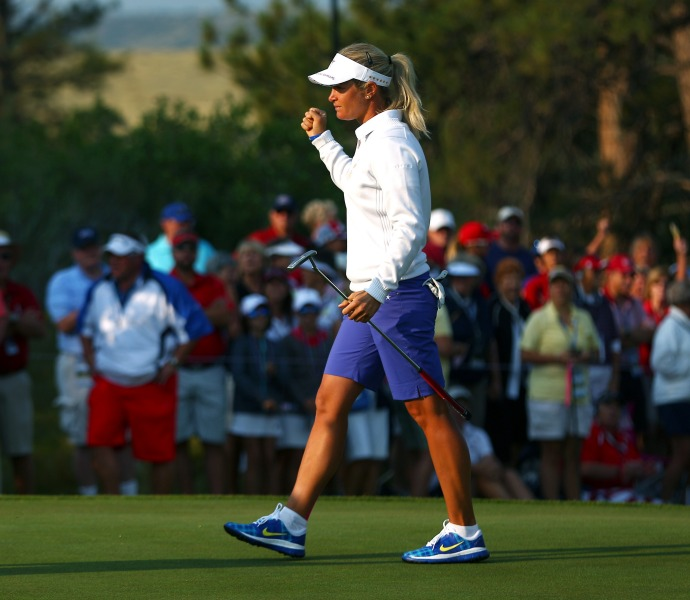 Suzann Pettersen makes a putt on the second hole.