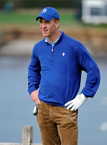 Peyton Manning waits to hit from the seventh tee in the second round.