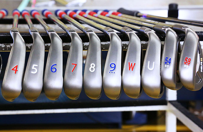The numbers and the grips on his irons are red, white and blue.