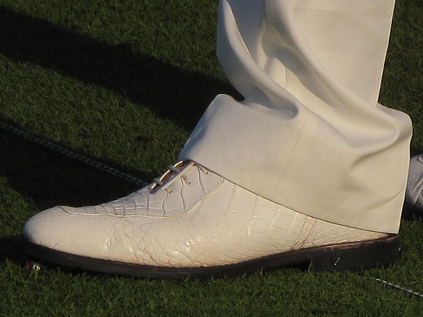 Mickelson's custom-made white shoes matched his belt perfectly. He told Stewart Cink on the range that he had new custom alligator shoes made in black and brown also.