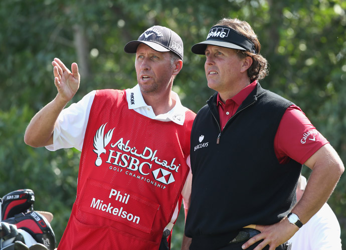 "Mickelson consults with longtime caddie Jim ""Bones"" Mackay."