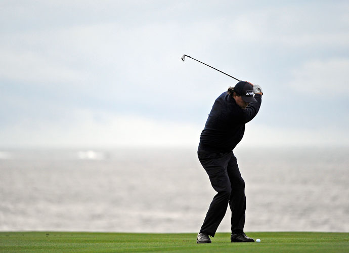 Phil Mickelson plays a shot from the eighth fairway in the second round.