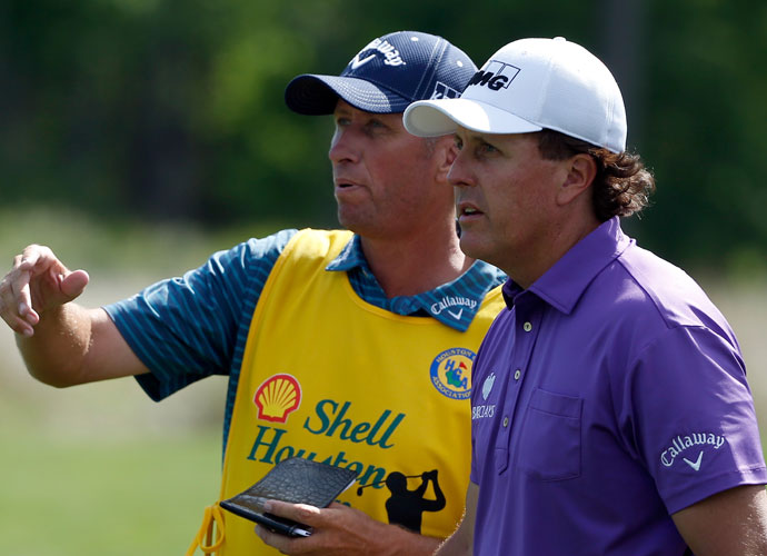 Phil Mickelson and Jim Mackay discuss a shot in the second round.