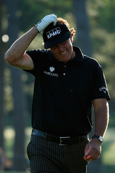 Phil Mickelson ponders a missed putt on the 17th hole.