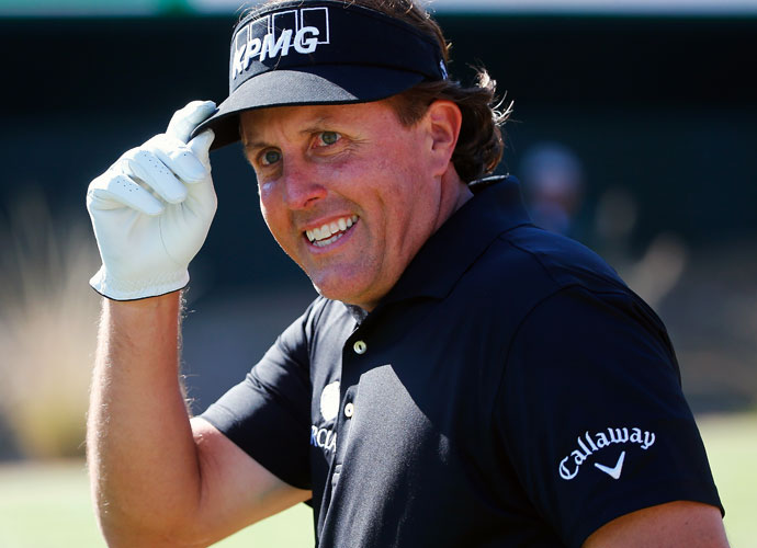 Phil Mickelson acknowledges cheers from more than 20,000 fans on the 16th hole.