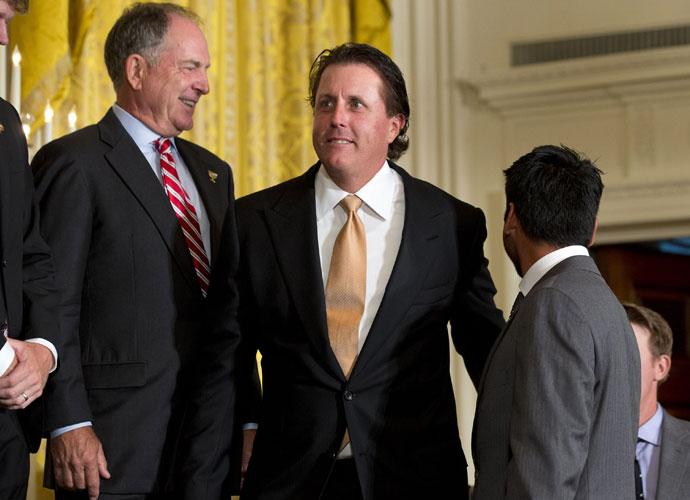 "Phil Mickelson arrives at the ceremony in the East Room of the White House. The President thanked Mickelson for an ""excellent tip"" about playing from the sand. ""I'm pretty sure I can shave at least two or three strokes if I can just get out of the darn sand,"" Obama said."