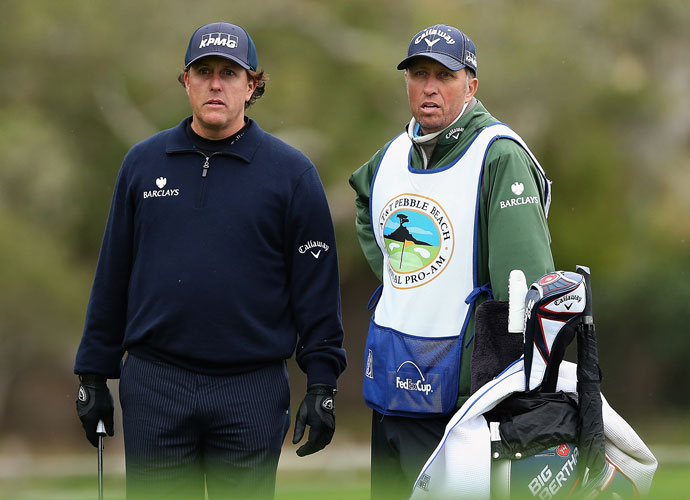 """Phil Mickelson and his caddie Jim """"Bones"""" MacKay play the 12th at Pebble Beach. Mickelson shot 73 to follow a first-round 66. He enters weekend play at -4, five shots behind Jimmy Walker and Jordan Spieth."""