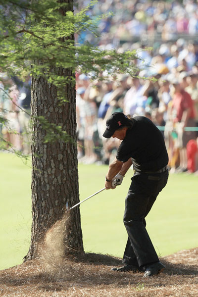 Phil Mickelson - 2010                                     With two pine trees, a creek, and 207 yards between him and the hole, Mickelson delivered a towering 6-iron off the pine needles through the trees to four feet. It was vintage Lefty, and one of the gutsiest shots ever played. Phil missed the ensuing eagle putt, but the birdie propelled him to a 67 (his third of the tournament) and his third green jacket.