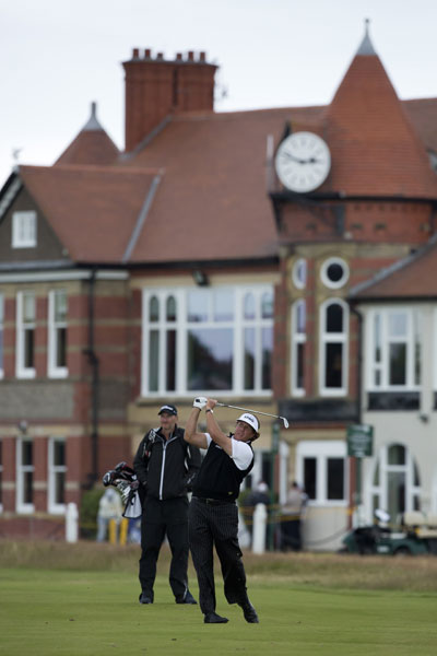 Phil Mickelson hits an approach shot on the third hole near the Royal Liverpool clubhouse.