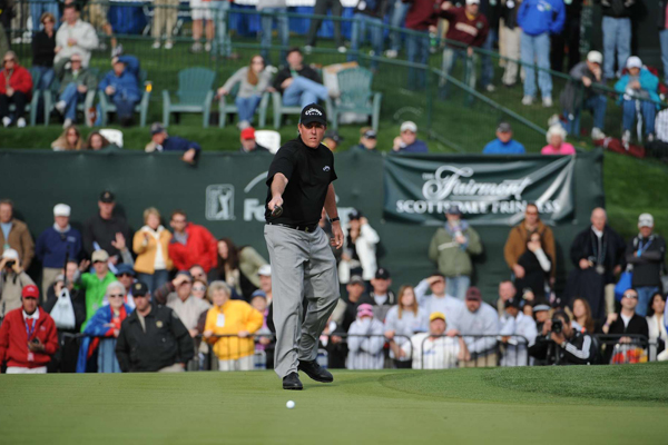 On the first playoff hole, No. 18, Mickelson raced his long birdie try past the cup.