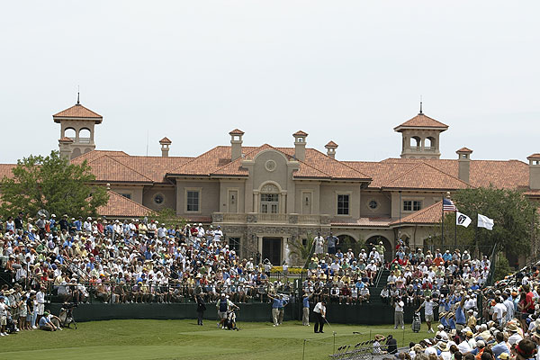 """Phil Mickelson teeing off on the first hole at TPC Sawgrass, with the enormous  new clubhouse in the background."""