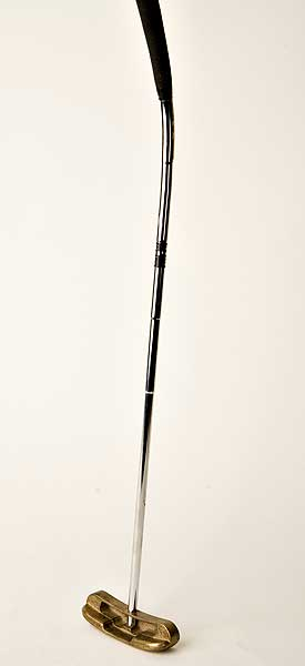 "This Ping creation, the 69BC putter, was released in the mid-60s but later banned by the United States Golf Association. Designed to be used croquet-style, the bend in the shaft was deemed to give an unfair advantage to the player. There is now a USGA rule that states, ""The shaft must be straight from the top of the grip to a point not more than 5 inches (127mm) above the sole, measured from the point where the shaft ceases to be straight along the axis of the bent part of the shaft and the neck and/or socket."""
