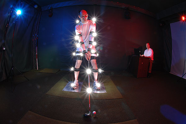 """At the University of Pittsburgh Medical Center's golf fitness lab, this man had his swing turned into a 3-D model so computers and scientists would be able to study it. They use ping-pong-ball-sized sensors to gather data, but I wanted to keep the area dark, and the sensors would not show up well with a camera-mounted flash. Instead, I put tiny strobe lights on him, and they went off as I snapped the shutter. Pretty cool."